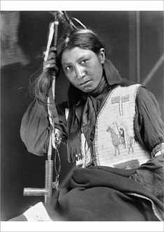 """An A1 poster sized print, approx 23""""x33"""" (841x594mm). SIOUX NATIVE AMERICAN, c1900.   Charles American Horse, a young Oglala Sioux, holding a peace pipe. Photographed by Gertrude Kasebier, c1900. 1890, 1890s, 1900, 1900s decade, american horse, blanket, boy, charles, clothing, embroidery, gertrude, holding, horse, indian, kasebier, neckerchief, oglala, peace pipe, teenage, traditional, tribal art, vest. Image supplied by Granger Art on Demand. Product ID:dmcs_12226548_80444_0 Native American Beauty, Native American Photos, American Spirit, Native American Tribes, Native American History, American Art, American Quotes, American Symbols, American Women"""