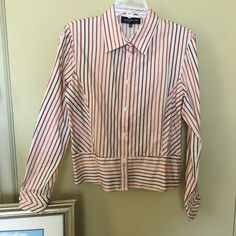 Jones New York Blouse Jones New York Signature blouse pinstripe and long sleeves with a peplum flap- button down- gently worn and in excellent condition Jones New York Tops Button Down Shirts