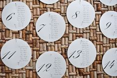 Paper circles pinned to a board create a striking seating chart. Loving this idea! {Lennon Photo}