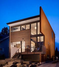 Gorgeous exterior....interesting fireplace, love the base cabinets in the kitchen and bathroom, the large street number on the window is cool...I wish descriptions were included with photos.    Beet Residence by Chadbourne   Doss Architects