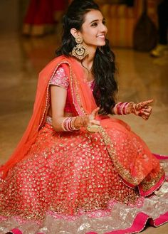 coral and pink lehenga, sister of the bride, grooms sister, net lehenga, shimmery, light , neon, bright,Manish Malhotra