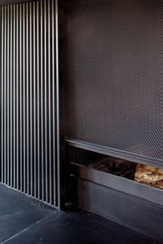 Great details on this Fireplace./ wood slotted panels and a mesh grate over the fireplace Fireplace Hearth, Home Fireplace, Modern Fireplace, Fireplace Design, Fireplaces, Library Fireplace, Architecture Details, Interior Architecture, Interior And Exterior