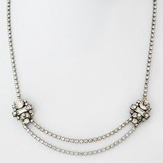 Erin Cole Designer Bridal Jewelry. Petite crystal brooch necklace when your bridal gown requires a little bit of sparkle at the neckline.