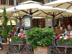 Sit and have an espresso at this sidewalk cafe in a piazza in Florence