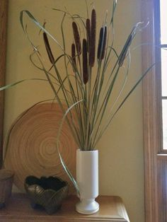 preserving cattails for decor use, gardening, home decor, The cattails look simple and elegant on the mantle Learn how to arrange them by reading the post