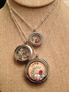 This shows the 3 different sizes & gives you an idea of how many charms can fit in them. Origami Owl Living Lockets