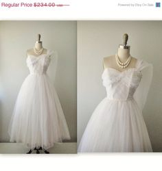 STOREWIDE SALE 50s Wedding Dress // Vintage 50s Strapless White Tulle Wedding Dress Gown XS by TheVintageStudio on Etsy https://www.etsy.com/listing/151260378/storewide-sale-50s-wedding-dress-vintage