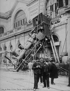 A Paris express train after it crashed through the Gare Montparnasse station wall, Paris, 1895.