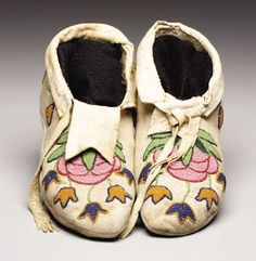 A PAIR OF PLATEAU BEADED HIDE MOCCASINS