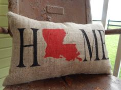 This offering comes from a custom order I fell in love with. A twist on our Home pillow with the state of your choosing in place of the O in HOME.