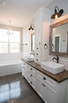 Easy Ways To Love Your Home; Farmhouse Bathroom Decor Ideas As far as home-improvement projects go, it's not the scale of the changes that you make. Wooden Bathroom Vanity, Modern Bathroom, Small Bathroom, Farmhouse Bathroom Sink, Wood Counter Bathroom, Farm House Bathroom, Vessel Sink Bathroom, Bathroom Vanities, Bathroom Countertops