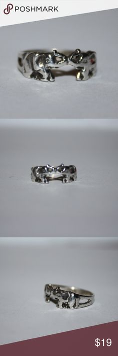 Trunk Up two elephants sterling silver ring Lucky! Vintage size 5.5 sterling silver ring. Has two elephants with trunks up. Double the luck! Buy from me with confidence! I have sold over 300 items with a 5 star rating! If you have any questions, do not hesitate to ask.  Looking at a few things in my shop? Put a bundle together, comment on an item that you are ready to check out and let me send you an even better offer!  Thank you for visiting :) Free gifts with every purchase! Jewelry Rings