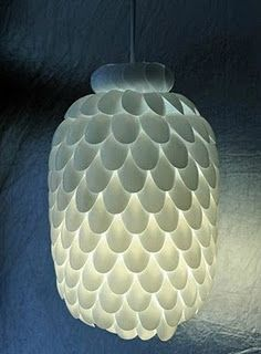 A DIY lamp made of plastic spoons.