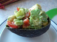 Avocado, cucumber, tomato, onion salad with lime.