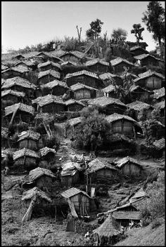 by Philip Jones Griffiths  - ALGERIA. 1962. Regroupment camp in the mountains of Kabylie Magnum Photos Photographer Portfolio, pin by Paolo Marzioli