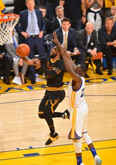 Kyrie Irving of the Cleveland Cavaliers goes up for the layup against the Golden State Warriors during the 2016 NBA Finals Game Seven on June 19 2016...
