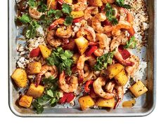 Make Sheet Pan Hawaiian Shrimp In 20 Minutes | This incredibly easy seafood dinner uses fresh pineapple and a teriyaki-style sauce for the classic sweet-and-tangy profile of Hawaiian shrimp. The pineapple also concentrates as it bakes and helps keep the rice mixture from becoming too dry. Rather than spreading the rice to the far edges of the sheet pan, keep it closer to the center and layer the vegetables and shrimp on top. This way their juices seep right into the rice, and the teriyaki