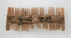 Double-Sided Comb Date: 7th century Geography: Made in Niederbreisig, Germany Culture: Frankish Medium: Bone, iron pins Dimensions: Overall: 3 3/8 x 1 3/8 x 1/2 in. (8.6 x 3.5 x 1.2 cm)