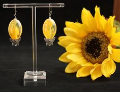 Yellow acrylic focal beads with butterflies and tiny accent beads Silver tone kidney shape ear wires