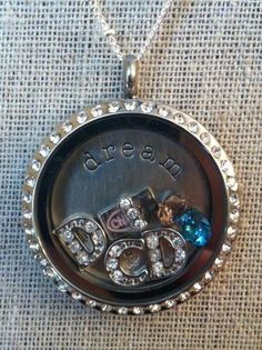 Dove Chocolate Discoveries Locket  http://www.mydcdsite.com/joyfullysweet Interested in sharing chocolate with people for a living, ask me how, Chocolatier Mentor #18858 or to make this locket contact me at www.joyfulstory.origamiowl.com