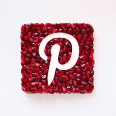 Pinterest icon made from toast, berries, and cream cheese