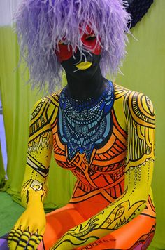 Artist Celery Jones designed and painted this bold-patterned mannequin, on display to show off our new collection of Body Art paints, glitters, ...