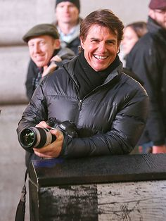 Star Tracks: Tuesday, December 2, 2014 | CAMERA-READY | Tom Cruise takes some time out of filming the latest installment of Mission: Impossible to play photographer in London's Piccadilly Circus on Monday.