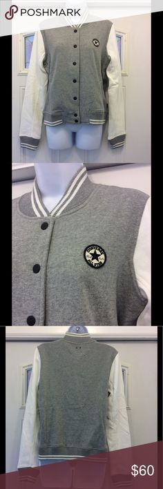 Converse Womens GF Core Fleece Varsity Jacket Product Detail: Converse varsity jacket. Woven badge branding. 80% cotton 20% polyester. Press-stud fastening. Ribbed collar, cuffs and hem. Side pockets. Converse Jackets & Coats