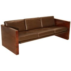 Vintage Milo Baughman Rosewood and leather sofa USA 1960's A lovely vintage sofa designed by Milo Baughman with Rosewood side panels and bronze finished bar supports. The leather cushions are a burnished medium brown.