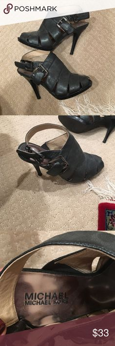 Michael Kors heels Gun metal strappy Michael Kors heels. Worn only twice and in great condition. Super cute shoes! Approximately 3.5 inch heel and 1/2 inch platform. Michael Kors Shoes Heels