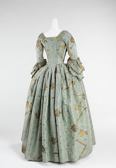 Dress (Robe à l'Anglaise)  Date:1770–75  Culture:British  Medium:silk, metal  Women with coquettish airs were imposing in robes à la française and robes à l'anglaise throughout the period between 1720 and 1780.  (hoop-skirts-and-corsets Tumblr)