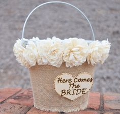 Here Comes the Bride Flower Girl Tin Pail! Pail is wrapped with a natural jute burlap. The pail will include the top (all the way around, not just the front) lined with beautiful soft sola flowers (th