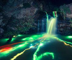 Long Exposure Of Glowsticks In A Waterfall