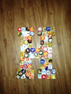 Big Wooden Letters from hobby lobby, turn up bottle cap lids with pliers, then flatten with a hammer & shape with pliers to fit letter, secure on with gorilla glue. #tsm #tfm #diy #crafts