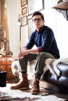 navy sweater over lumberjack plaid shirt, paired with cuffed olive trousers and vibram soled camel boots.