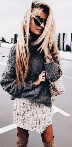 Gray knit sweater with textured fringed mini skirt and beige OTK boots.