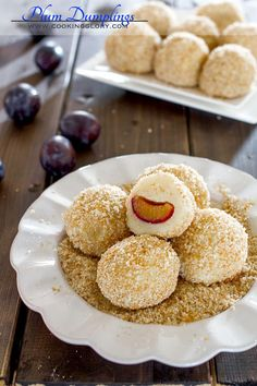 These plum dumplings are a traditional Romanian dessert made of fresh plums rolled into a soft potato dough, covered with a breadcrumb-sugar mixture. Just Desserts, Delicious Desserts, Dessert Recipes, Yummy Food, Tasty, Romanian Desserts, Romanian Food, Romanian Recipes, Hungarian Recipes