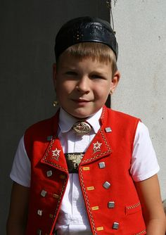 Boy in traditional dress with cow ringer in the ear | Flickr - Photo Sharing! Swiss