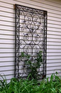 Garden Trellis Design Ideas I want this out front for my climbing rose. :)