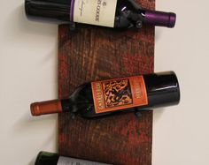 Items similar to Reclaimed Wood Industrial Wine Rack on Etsy