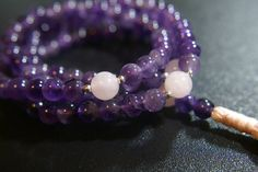 Check out this item in my Etsy shop https://www.etsy.com/listing/229579991/108-ct-8mm-amethyst-mala-with-rose