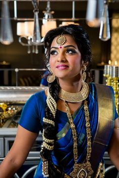 Oh the beauty of pearls around a long braid. Ideal for a South India wedding :)