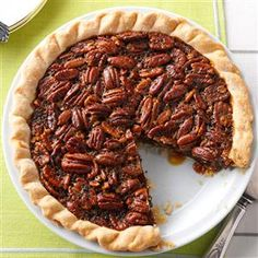 Molasses-Bourbon Pecan Pie Recipe -Guests' mouths water when they glimpse this Southern charmer. Its flaky crust perfectly complements the rich, nutty filling. —Charlene Chambers, Ormond Beach, Florida