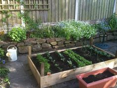Vegetable patch raised and cornered off with stone wall
