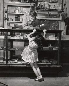 "Joe Leighton waits on a young customer, Vanderpool, TX, 1945 (Esther Bubley) """