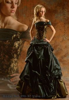 this would b my #2 dress. the only prob is it reminds me of just a formal gown not so much a wedding gown mybe with black n gold veil and I beautiful red gold n black flower bouquet?