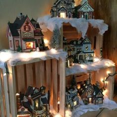 """My 2015 village display! Made using crates Christmas lights and """"snow"""" Love this idea for my Christmas Village. Walmart sells these crates. Noel Christmas, Country Christmas, Christmas Projects, Christmas Lights, Christmas Ideas, Griswold Christmas, Christmas Baskets, Victorian Christmas"""