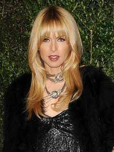 Rachel Zoe's bangs are trimmed with a razor in two sections: one that falls directly over the forehead, then longer layers on the sides.