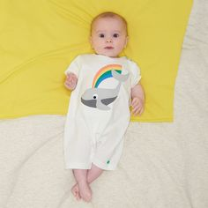 MOBY Organic Cotton Rainbow Whale Unisex Baby and Toddler Playsuit/Romper. Our happy little whale applique embroidery sprays rainbow rays wherever he goes.