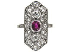 This is a beautiful ring which has a central ruby and is surrounded by a mixture of old brilliant cut diamonds and rose diamonds. The diamonds are millegrain set which is a technique used in the early 20th century when working with platinum. The result is a very neat look unlike the claw set stones …